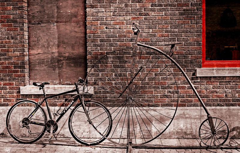 Bicycle on brick wall