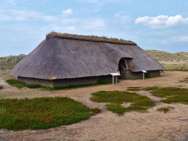 Reconstruction of a prehistoric iron age thatched-roof turf house on the island of Amrum Amrum Archaeology Experimental Turf House Building Exterior Dune Farmhouseliving Germany Heather Historic History House Iron Age Monument Museum Prehistoric Reconstructed Reconstruction Thatched House Thatched Roof Turf
