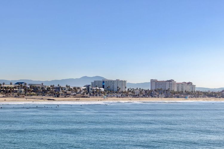 coastline of Huntington Beach California Sky Water Architecture Built Structure Building Exterior Copy Space Clear Sky City Sea Waterfront Land Nature Beach Blue No People Building Scenics - Nature Cityscape Day Outdoors View Into Land Huntington Beach Southern California Orange County Mountains Hotels And Resorts Hotels