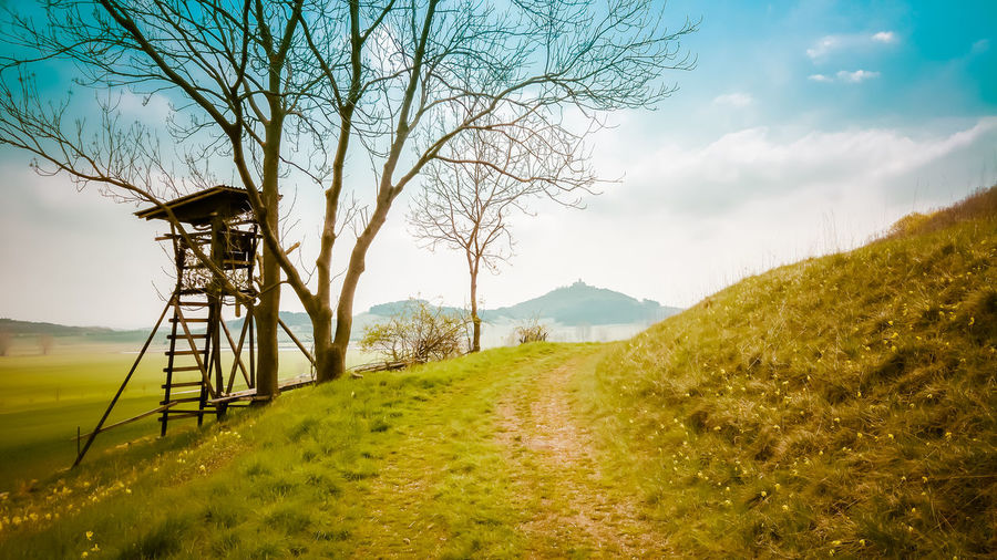 perch with view to an old Castle in Thuringia Bare Tree Beauty In Nature Cloud Cloud - Sky Field Grass Grassy Hochsitz Landscape Mountain Nature Non-urban Scene Perch Remote Scenics Sky Thuringia Tranquil Scene Tranquility Tree Wachsenburg