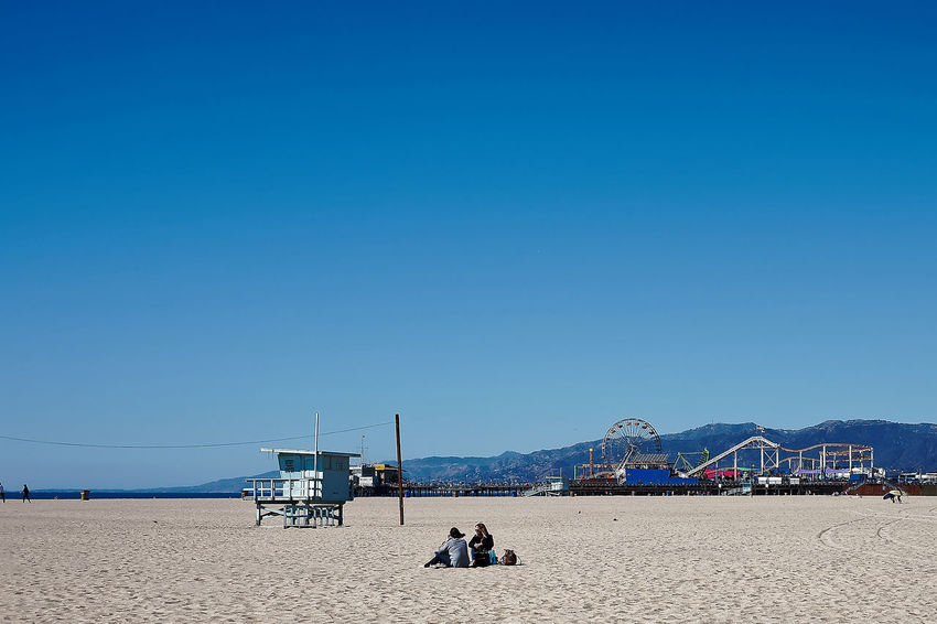 Santa Monica Wintertime Adult Beach Beach Volleyball Beauty In Nature Blue Clear Sky Day Leisure Activity Lifeguard  Lifestyles Men Nature One Person Outdoors People Real People Sand Sea Sky Vacations Water Women