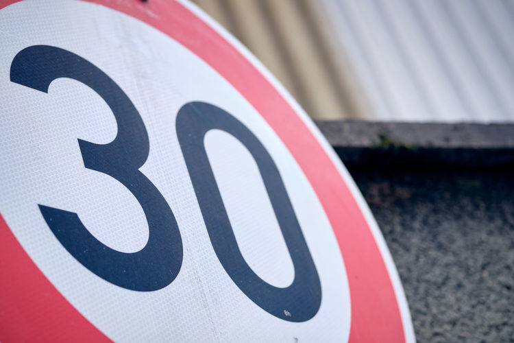 Close-up of speed limit sign on road
