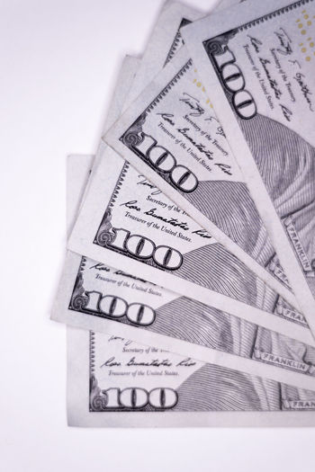 One hundred dollar bills fanned 100 Dollar Bills American Benjamin Franklin Bills Bitcoin Buying Cash Compensation Currency Digital Fraud Management One Hundred Pay Payday Payment Salary Selling Tax Wages Wallet Wealth