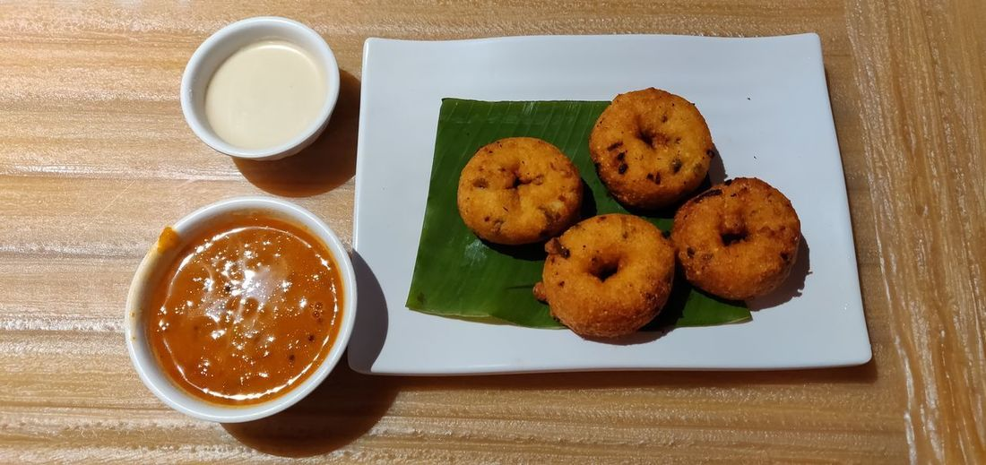 Wada Chutney Sambar Plate Dessert Table Drink Directly Above Sweet Food Close-up Food And Drink