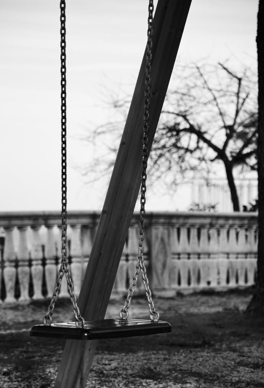 CLOSE-UP OF SWING IN PARK