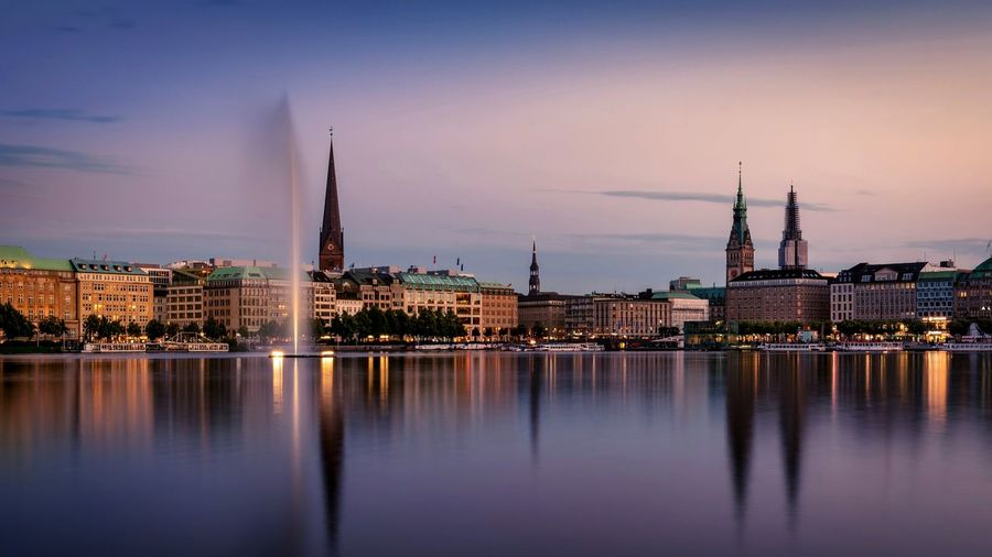 Binnenalster Lake By Buildings Against Sky During Sunset In City