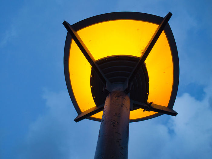 Low angle view of yellow light against sky