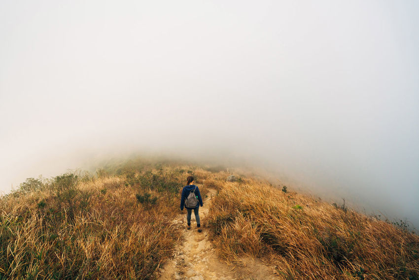 Hong Kong Adult Adults Only Adventure Backpack Beauty In Nature Day Exploration Fog Full Length Grass Healthy Lifestyle Hiking Landscape Mature Adult Mountain Nature One Man Only One Person Only Men Outdoors People Rear View Walking Young Adult