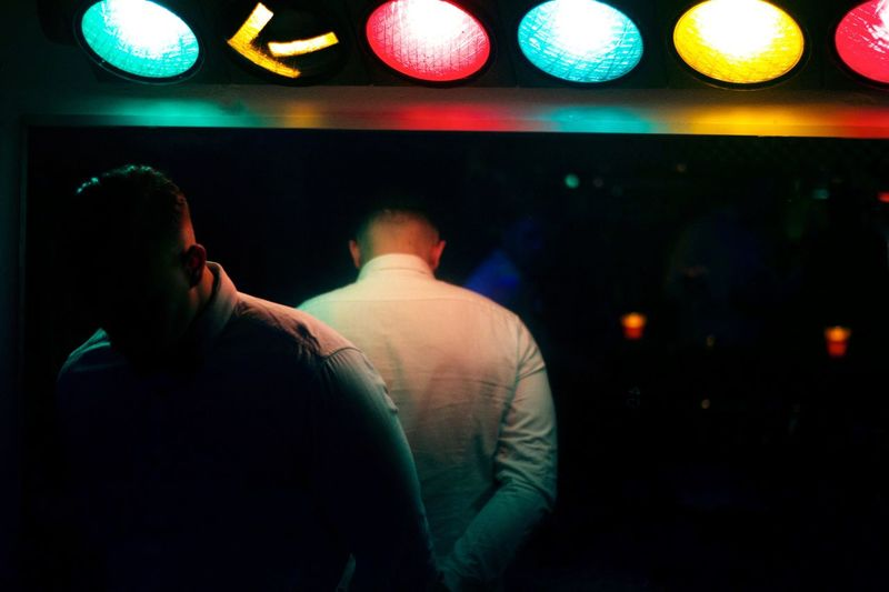Night Nightlife Illuminated Enjoyment Fun Arts Culture And Entertainment Man Indoors  Real People Togetherness Spectator Lifestyles Nightclub Friendship Projection Equipment Young Adult Colors Color Colorful Shadows & Lights Darkness And Light People