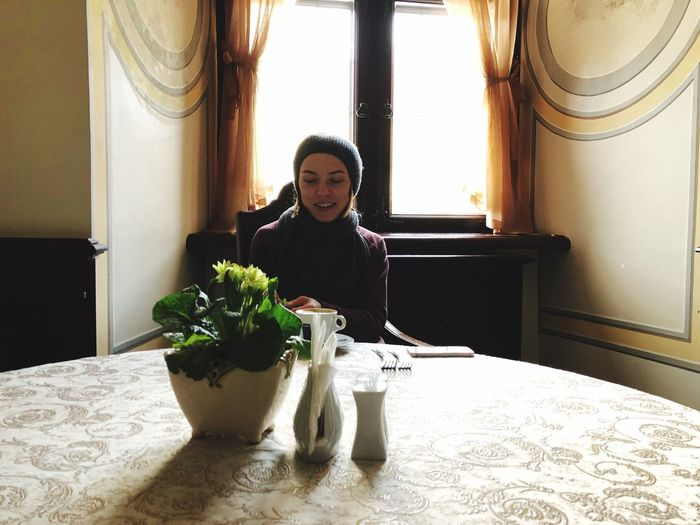 Woman With Houseplant On Table At Home
