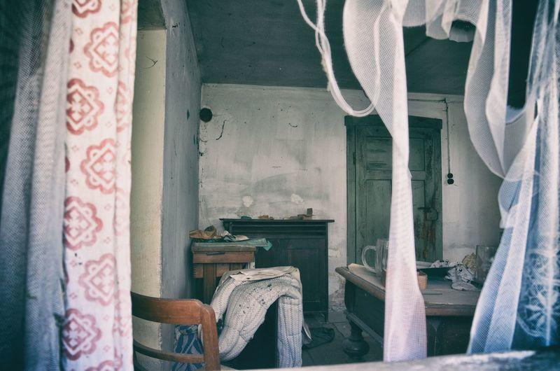 EyeEm Best Shots EyeEm Gallery Abandoned Absence Architecture Building Chair Clothing Curtain Damaged Day Domestic Room Floral Pattern Furniture Home Interior House Indoors  Lostplaces Messy No People Obsolete Old Seat Textile Window