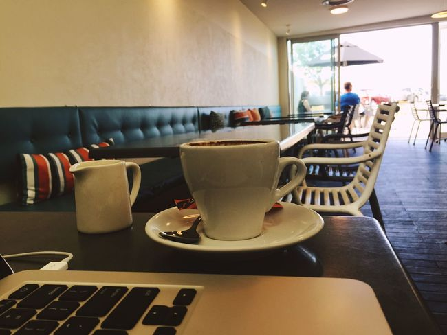Because of the nature of my work, all I need is a laptop and my headphones and I can work anywhere!! Interior Views Coffee Cafe Relax Two People Computer Coffee Cup Doorframe