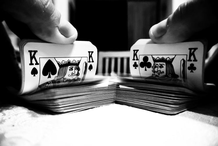 Close-up of hands shuffling cards