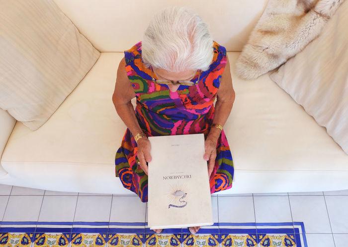 Books Colors Decameron EyeEm Best Shots EyeEm Gallery EyeEmBestPics Fuji Fujifilm FUJIFILM X-T10 Fujifilm_xseries Grandmother Multi Colored People Reading Reading A Book Sofa White White Background White Hair Woman