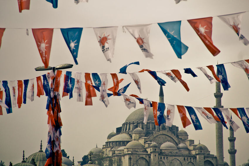 Architecture Bunting Day Flag Hanging Istanbul Istanbul Turkey Large Group Of Objects Multi Colored No People Outdoors Place Of Worship Religion Sky Spirituality Travel Destinations Turkey