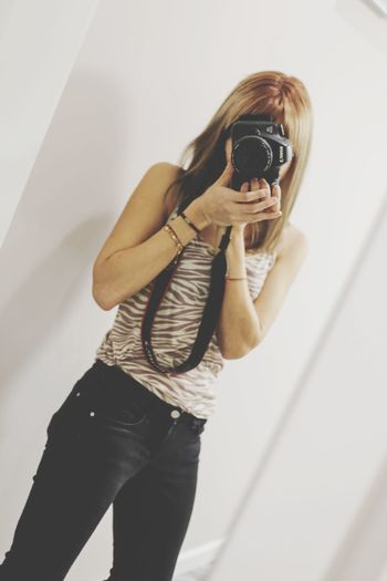 Look through EyeEm Selects Photographing Camera - Photographic Equipment Photography Themes One Person Holding Technology Photographer Young Adult Real People Young Women Camera Standing Full Length Digital Single-lens Reflex Camera Wireless Technology People Love Yourself