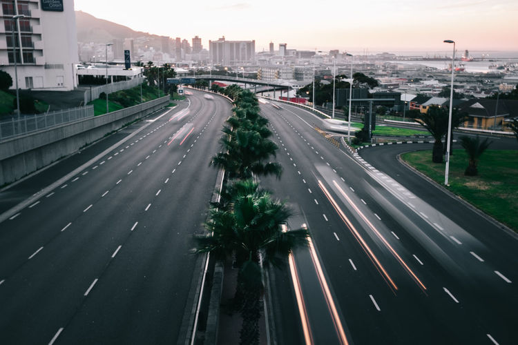 A view into town at Sunset Capetown City City Life Cityscape Diminishing Perspective High Angle View Highway Motion Outdoors Road Road Sunset The Way Forward Transportation