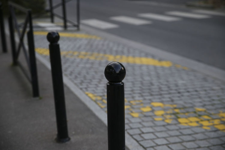 // this was my first time ever in Paris. So many Colours and so many different Cultures are living here. // The Traveler - 2018 EyeEm Awards Bollard City Day Dividing Line Focus On Foreground Footpath High Angle View Marking Metal No People Outdoors Protection Railing Road Road Marking Safety Security Sign Street Transportation Yellow