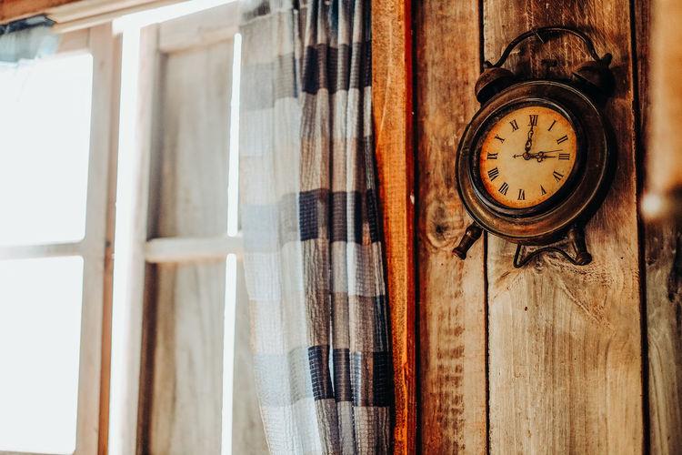 Close-up of clock on window