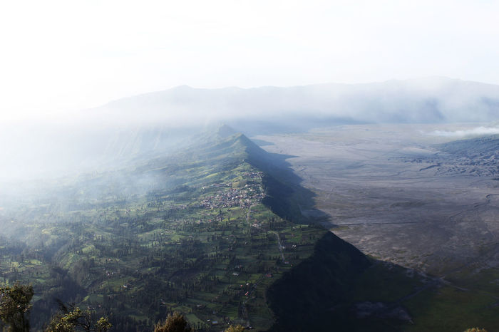 Cemoro Lawang village, East-Java, Indonesia. Aerial View Beauty In Nature Bromo Tengger Semeru National Park Cemoro Lawang Cityscape Day East Java, Indonesia Fog High Angle View Landscape Mountain Nature No People Outdoors Sky Social Issues Travel Travel Destinations Tree
