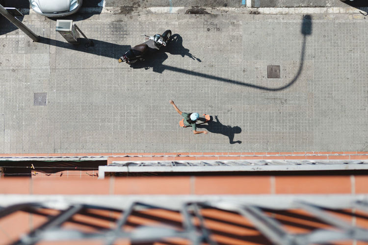 High angle view of people jumping on building