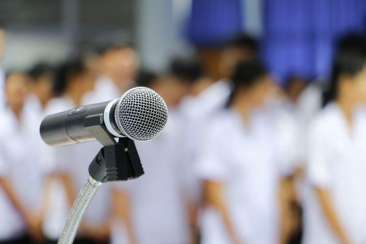 Close-up of microphone against defocused people
