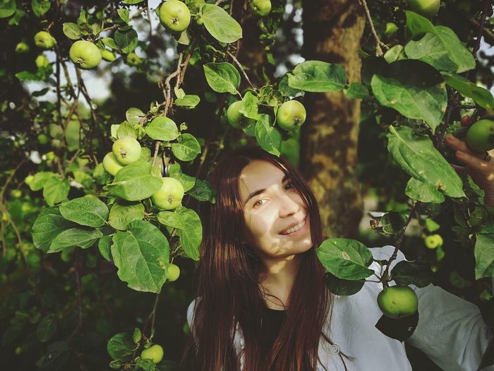 Girl and apple tree Apple Apple Tree Green Color Hair The Portraitist - 2018 EyeEm Awards Tree Young Women Beautiful Woman Beauty Women Beautiful People Leaf Portrait Fairy Branch Fruit Tree Apple Blossom