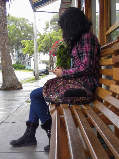 18 - 25 Yo Bench Casual Clothing Day Lifestyles Outdoors Park Bench Person Rear View Relaxation Resting Sitting