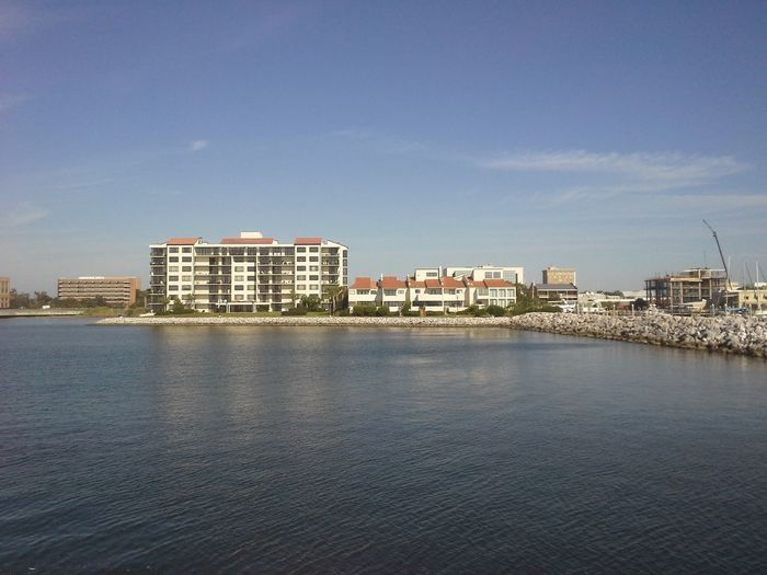 A view of Port Royal from Palafox Pier - Pensacola, Florida Architecture Beauty In Nature Blue Building Building Exterior Built Structure City City Life Cityscape Cloud Cloud - Sky No People Outdoors Pensacola Florida Port Royal Pensacola Residential Building Residential District Residential Structure Rippled Scenics Sky Tranquil Scene Tranquility Water Waterfront
