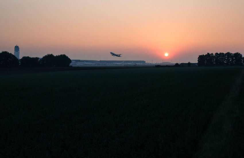 Airport Day Field Flying Landscape Nature No People Orange Color Outdoors Silhouette Sky Sun Sunrise Sunset TakeOff