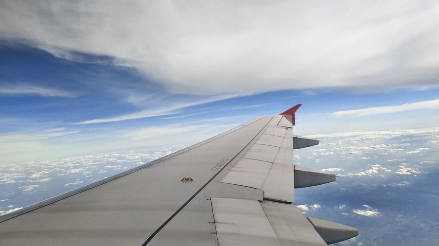 Aircraft wing against sky