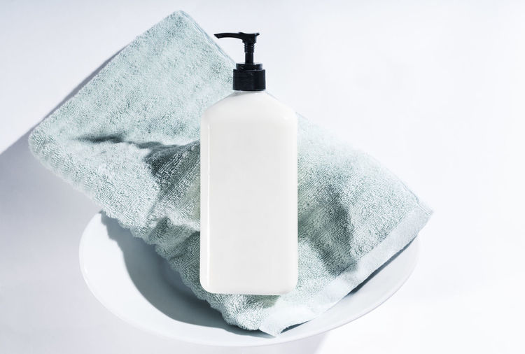 Lotion Aqua Backgrounds Bath Beauty Products Close-up Day Dermatology Face Cream Hydrating Hygiene Moisturizer No Label No People Perfume Product Product Photography Rejuvenation Relaxation Skin Care Soothing Still Life Studio Shot Towel Towels White Background
