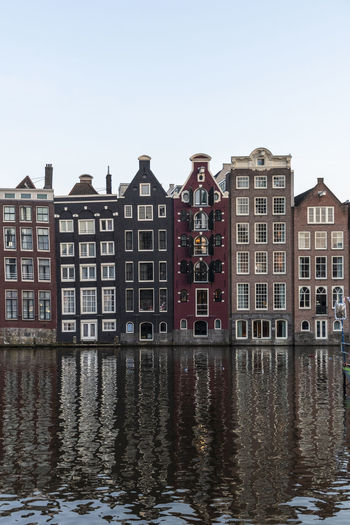 View of building by canal in city