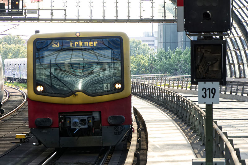 Train on road in city