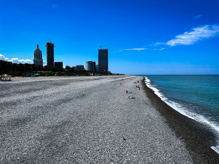 Scenic view of beach against sky in city
