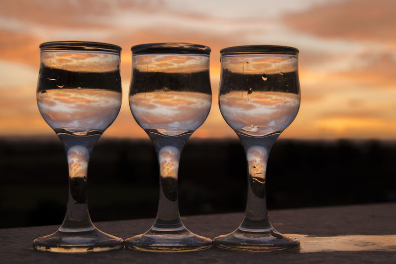 Wine glasses on a sunset view Food And Drink Drink Glass Refreshment Alcohol No People Close-up Transparent In A Row Drinking Glass Glass - Material Freshness Focus On Foreground Still Life Side By Side Indoors  Household Equipment Wine Table Group Of Objects Red Wine Temptation