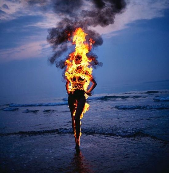 #sea #fire Real People Burning Flame Leisure Activity Motion Shades Of Winter Nature Sky One Person Water People Night