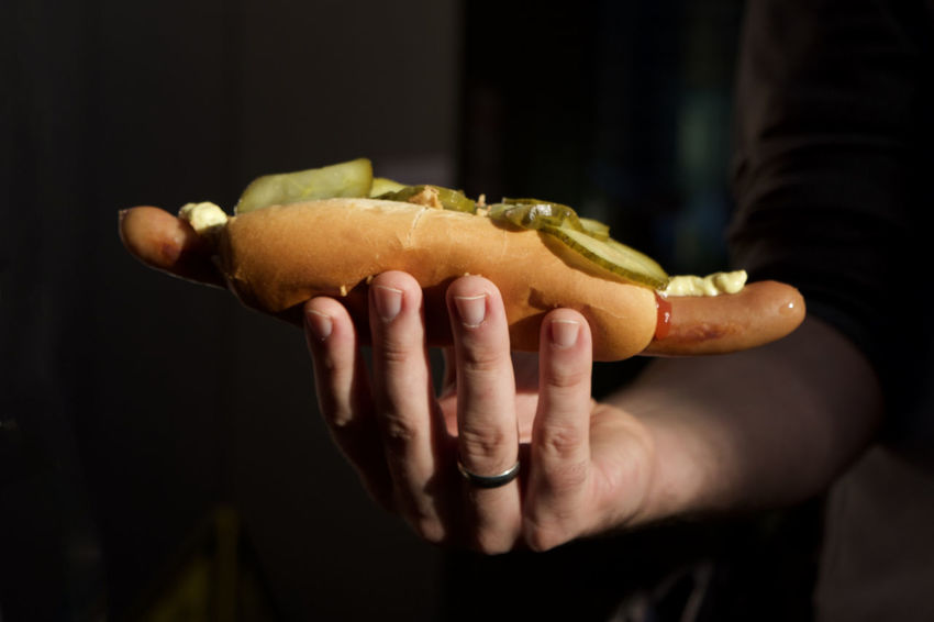 Copy Space Hot Dog Snack Snack Time! American Culture Close-up Day Focus On Foreground Food Food And Drink Freshness Holding Human Body Part Human Hand Indoors  Midsection One Person People Pickles Ready-to-eat Real People Ring Sausage Sunbeam Unhealthy Eating
