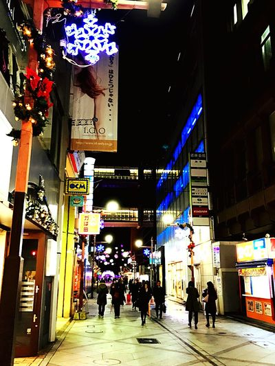 Night City City Street Street Illuminated City Life Store Built Structure Architecture People Men Outdoors Nightlife Large Group Of People Adults Only Adult