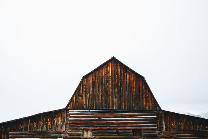 Barn in Wyoming Barn Barns Architecture Barn Barnyard Building Exterior Built Structure Clear Sky Copy Space Day No People Outdoors Sky Winter Wood - Material