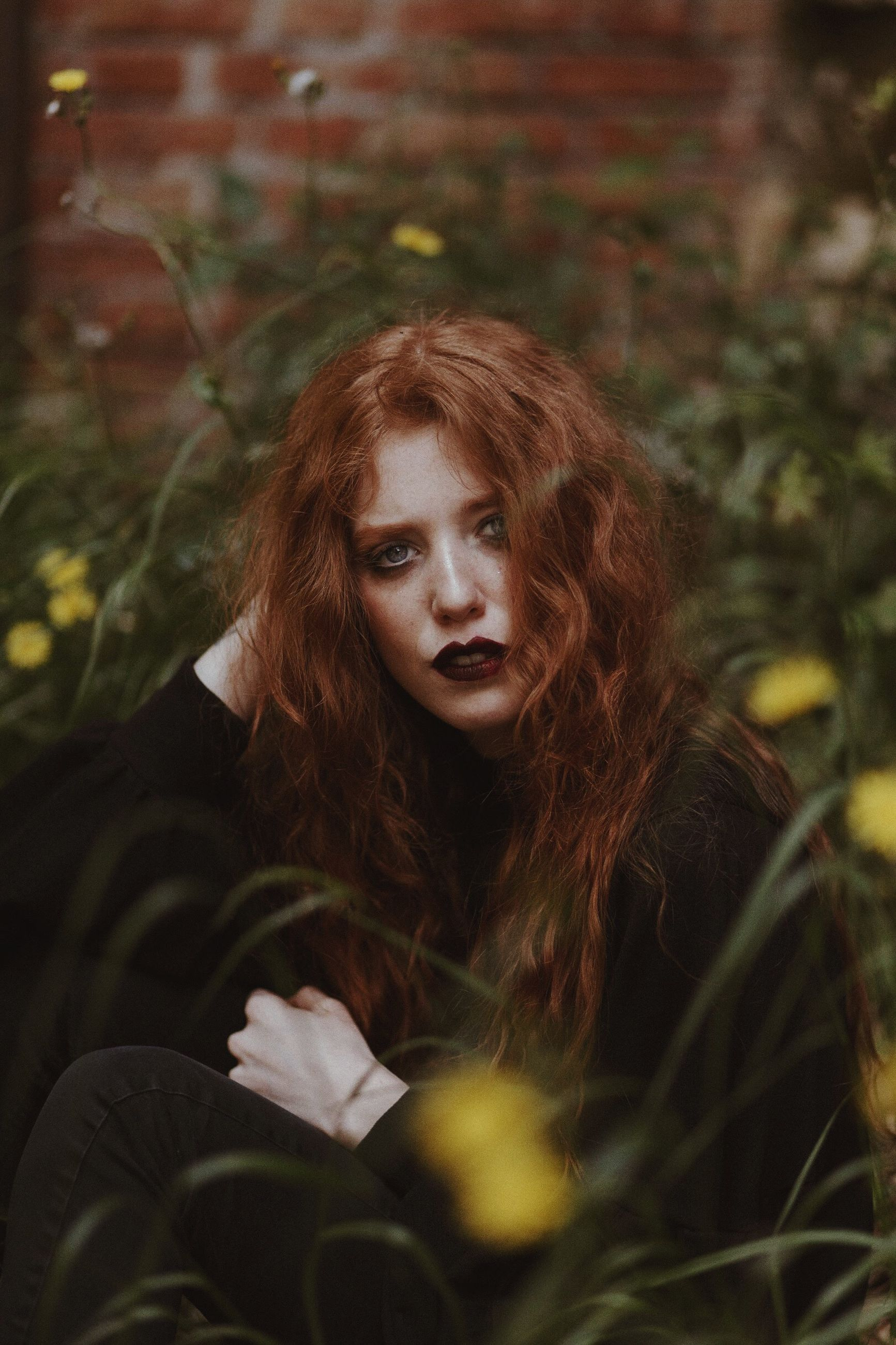 one person, young adult, portrait, young women, real people, leisure activity, looking at camera, lifestyles, front view, redhead, beauty, adult, beautiful woman, land, women, plant, selective focus, looking, hairstyle, hair, outdoors, contemplation