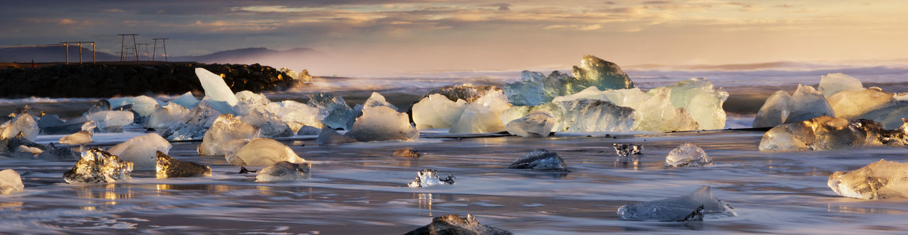 Water Ice Nature Sea Cold Temperature Frozen No People Outdoors Floating On Water Icebergs Ice Sculptures Sunrise First Light Iceland Tourist Attraction  Tourism Diamond Beach Iceland Landscape
