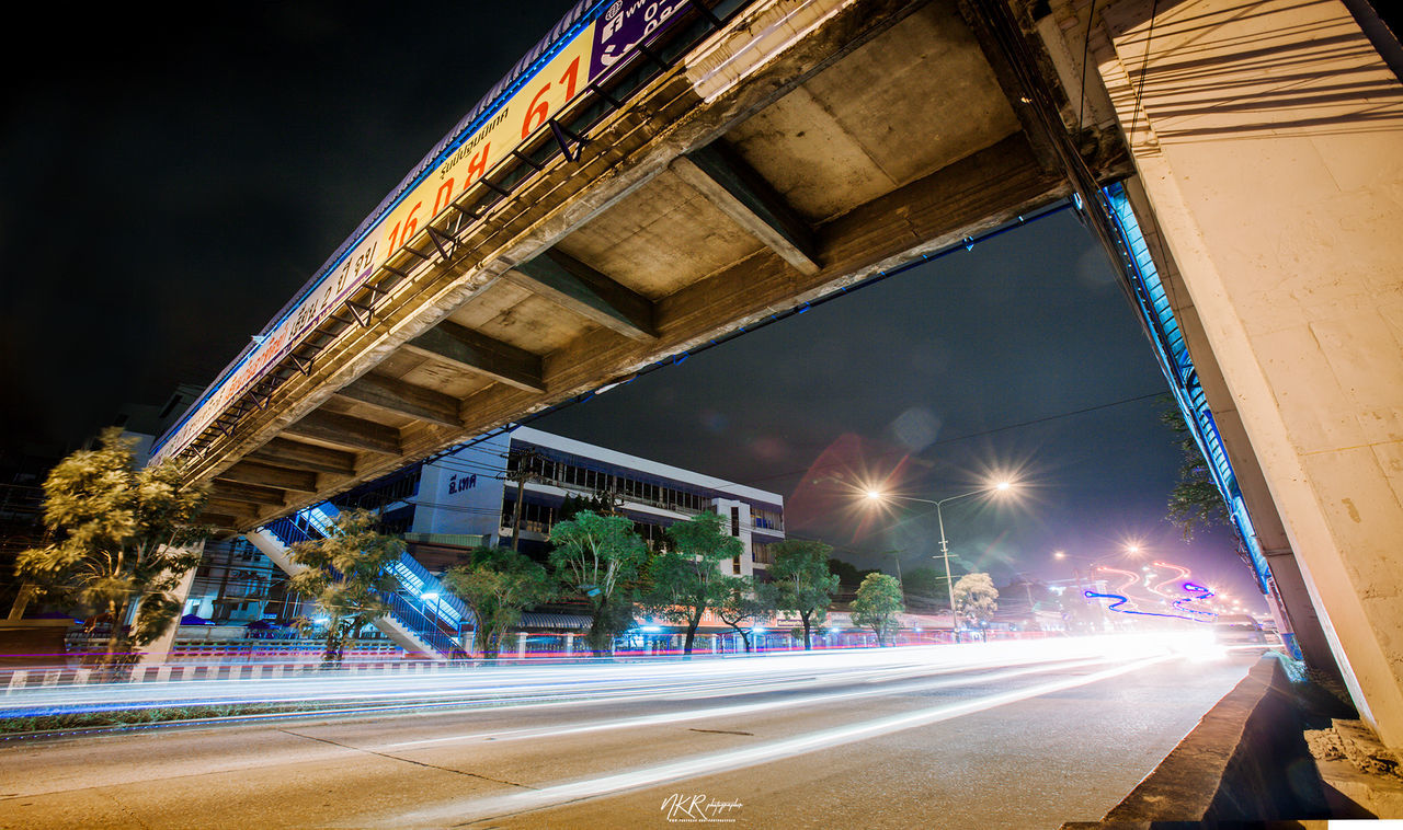 illuminated, road, transportation, architecture, long exposure, night, city, speed, light trail, built structure, motion, building exterior, blurred motion, street, no people, nature, sky, sign, symbol, bridge