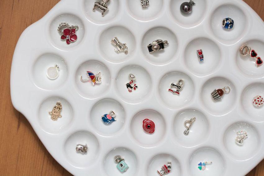 pandora sterling pendants in a white plate Bracelet Miniature Pandora Pendant Pendant Light Silver  Sterling White Background