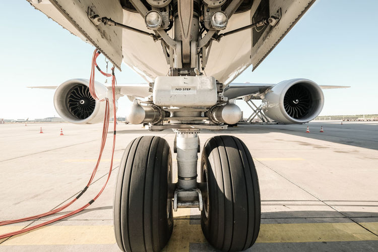 Aerospace Industry Air Vehicle Airplane Airport Airport Runway Close-up Day Land Vehicle Mode Of Transportation Nature No People Outdoors Private Airplane Propeller Sky Stationary Sunlight Tire Transportation Travel Wheel