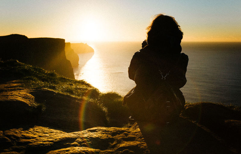 35mm Back Lit Cliffs Day Kodak Leica Leica M9 Leisure Activity Nature Enjoy The New Normal Outdoors People Real People Sea Silhouette Sky Sun Sunlight Sunset Trip VSCO Vscocam Waist Up Wanderlust Stories From The City Summer Exploratorium