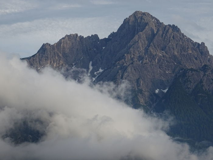 Mountain Beauty In Nature Cloud - Sky Scenics - Nature Tranquil Scene Sky Tranquility Mountain Range Nature No People Non-urban Scene Day Rock Idyllic Majestic Landscape Mountain Peak Environment Geology Formation Outdoors