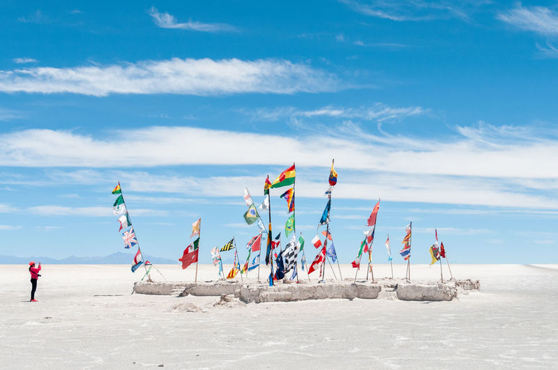 Uyuni is a city in the southwest of Bolivia. There is little agriculture in the area because water supplies are scarce and somewhat saline. Uyuni primarily serves as a gateway for tourists visiting the world's largest salt flats, the nearby Uyuni salt flat Uyuni Salt Flat Salt Flat Day Bolivia Dakar Bolivia South America Blue Sky Travel Destinations Men People Environment Vacations In A Row Outdoors Holiday Scenics - Nature Cloud - Sky Multi Colored Water Group Of People Beach Nature Land Blue Sea Sky