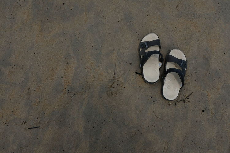 High angle view of sandals at beach