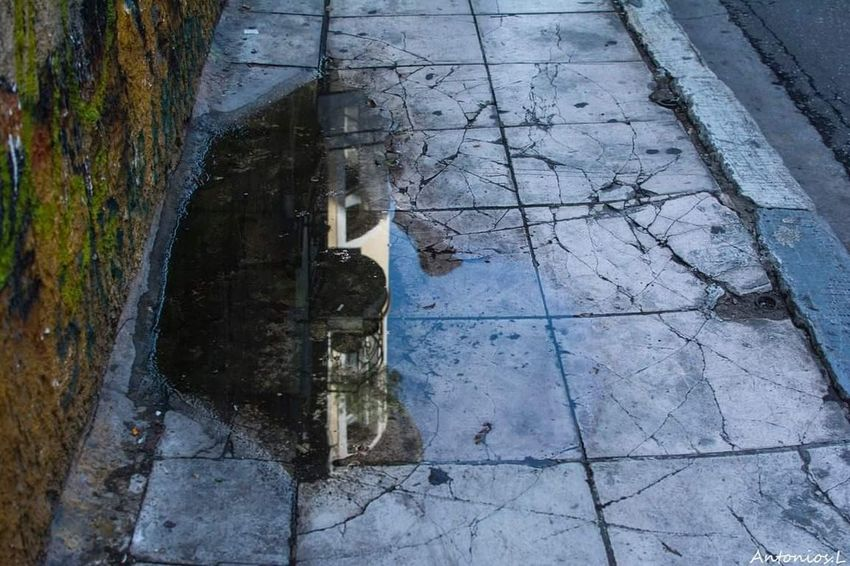 Street High Angle View Day Reflection Puddle Wet Outdoors